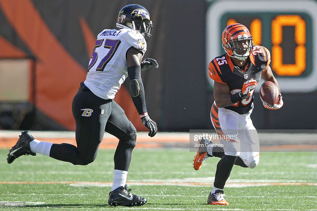 J Mosley of the Baltimore Ravens pursues Giovani Bernard of the Cincinnati Bengals during the second quarter at Paul Brown Stadium on October 26 2014...