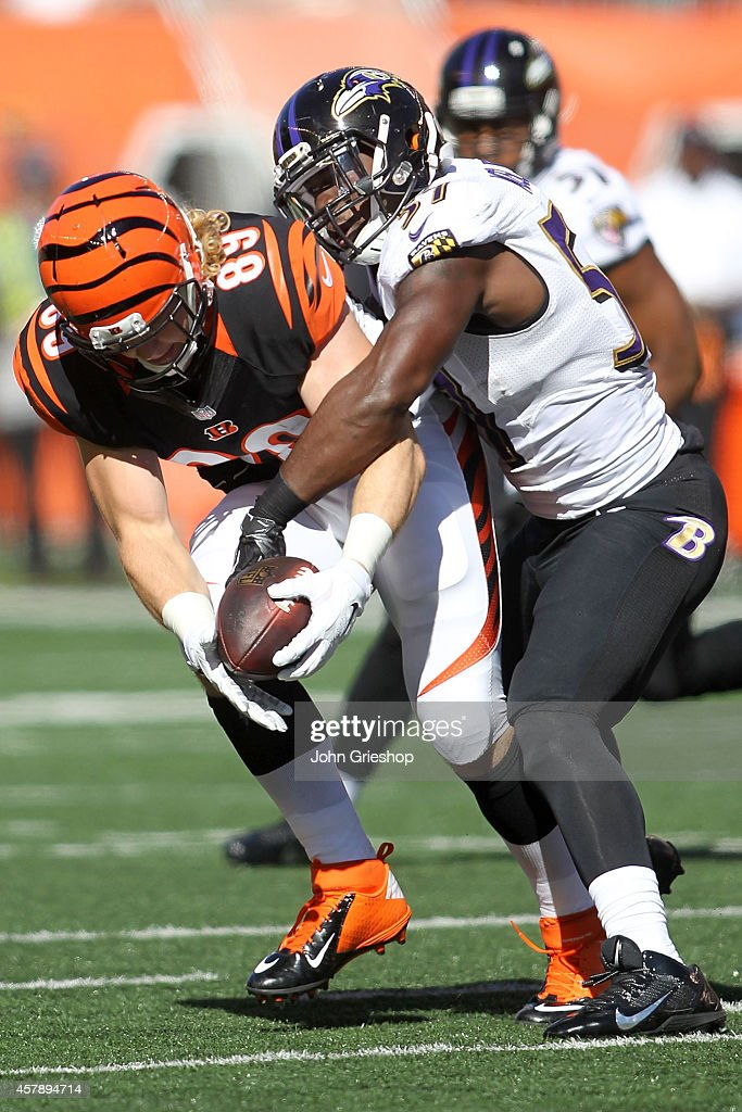 C.J. Mosley #57 of the Baltimore Ravens tackles Ryan Hewitt #89 of the Cincinnati Bengals during the second quarter at Paul Brown Stadium on October 26, 2014 in Cincinnati, Ohio.