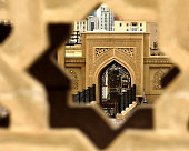 A view into the courtyard of a modern mosque in the centre of Baku, Azerbaijan, seen through a gap in a decorative wall.