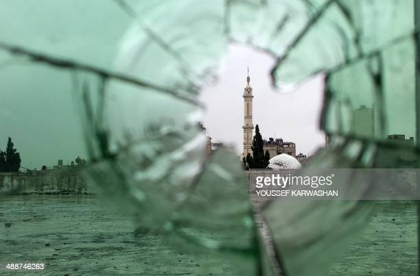A mosque is pictured through shattered glass in the old city of Homs on May 8 as rebel fighters withdrew from the city centre in line with a...
