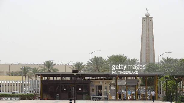 A mosque is seen behind the entrance gate to the administration area of Saudi Aramco headquarters on May 10 2016 in Dhahran 400kms east of the...