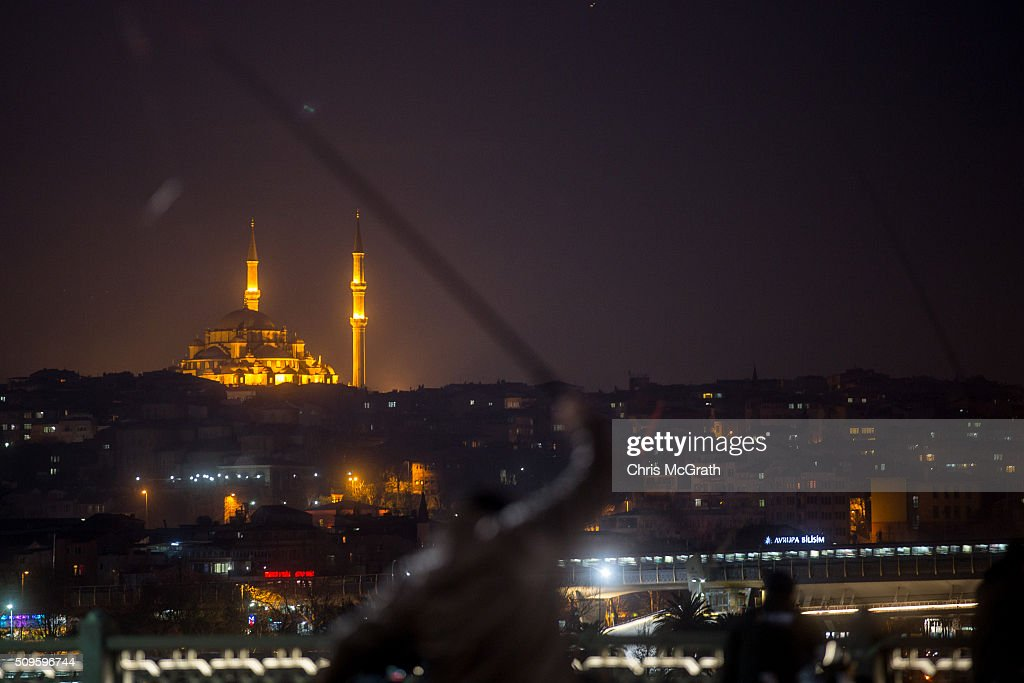A mosque is seen on a hillside as people fish off the Galata Bridge on February 11, 2016 in Istanbul, Turkey. Istanbul is famous for its skyline dotted with historic mosques, it is home to more than 3000 mosques, the most of any city in Turkey and includes the famous Blue Mosque and Suleymaniye Mosque.