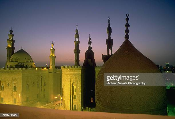 Mosque of Sultan Hassan and the Riafa'i Mosque at dusk Cairo Egypt