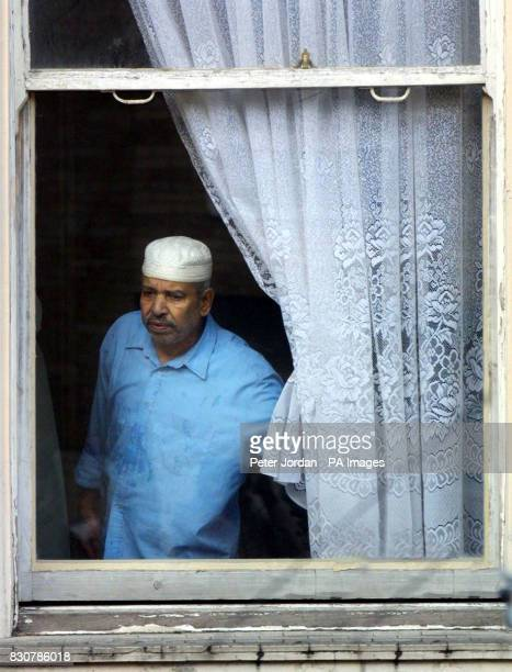 A mosque user looks out at the media at Brixton Mosque and Islamic Cultural Centre in London where British Muslim Richard Reid 28 attended before...