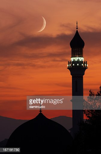 Mosque with crescent moon at dusk