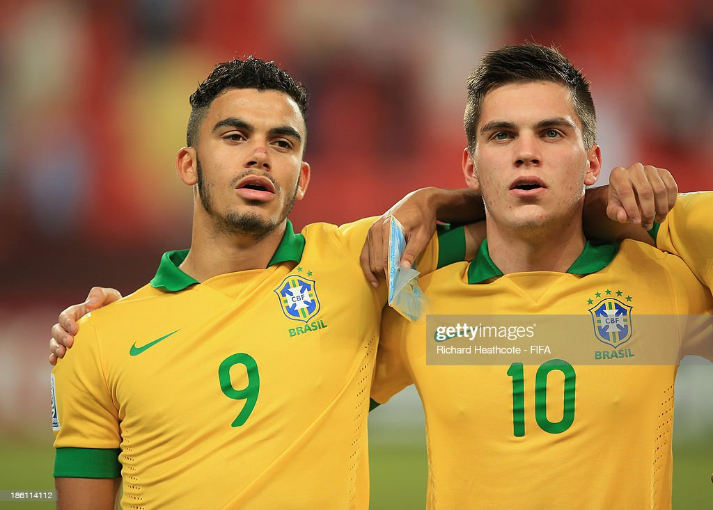 Mosquito and Nathan of Brazil sings the national anthem during the FIFA U-17 World Cup UAE 2013 Round of 16 match between Brazil and Russia at the Mohamed Bin Zayed Stadium on October 28, 2013 in Abu Dhabi, United Arab Emirates.