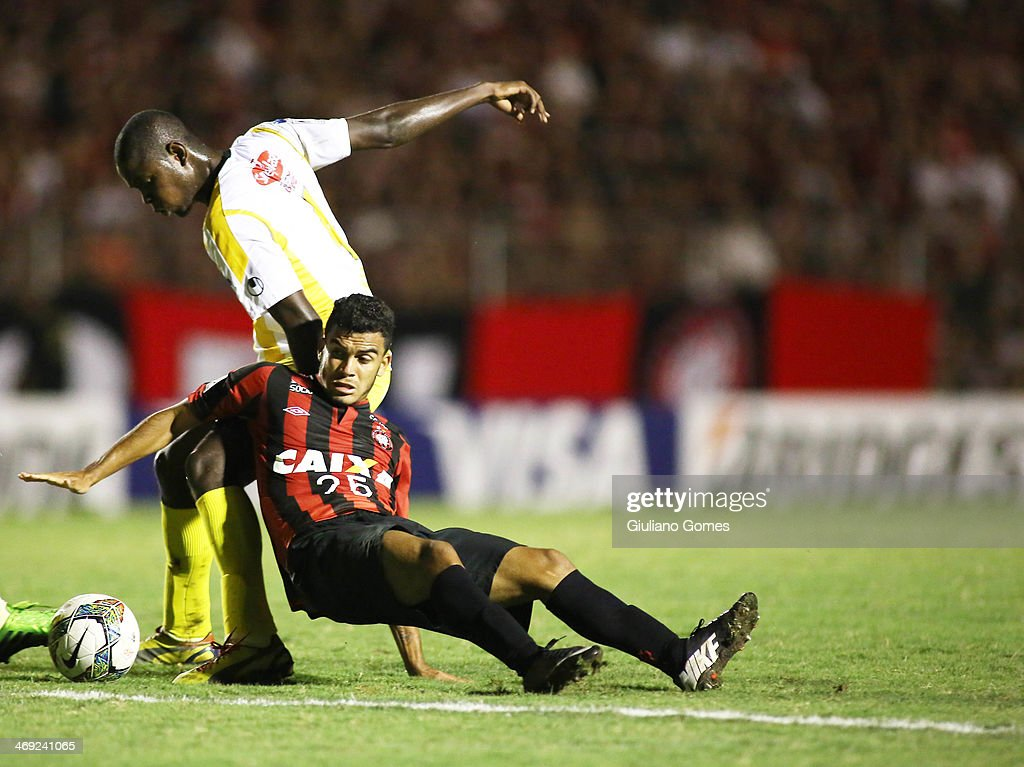 Mosquito (R) of Atletico Paranaense battles for the ball against Jefferson Lopez of The Strongest during a match between Atletico Paranaense and The Strongest as part of Copa Bridgestone Libertadores 2014 at Durival Britto Stadium on February 13, 2014 in Curitiba, Parana, Brazil.
