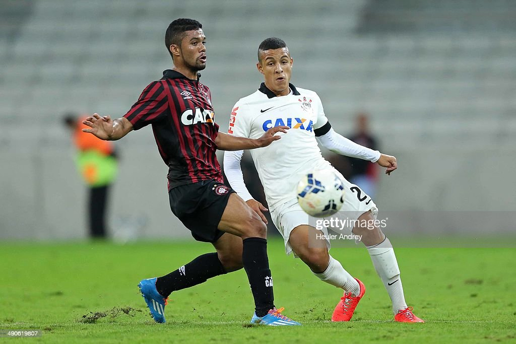 Mosquito of Atletico-PR competes for the ball with Guilherme Arana of Corinthians during the match between Atletico-PR and Corinthians for the Test Event FIFA at Arena da Baixada stadium on May 14, 2014 in Curitiba, Brazil.