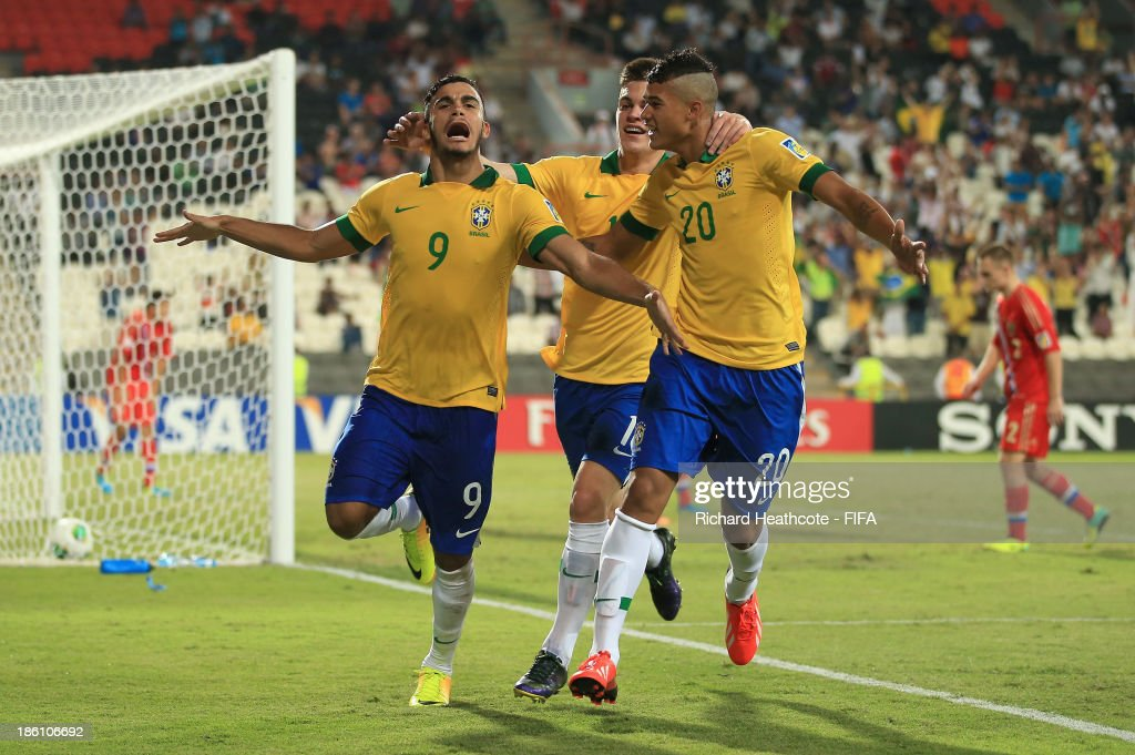 Mosquito of Brazil celebrates scoring the opening goal during the FIFA U-17 World Cup UAE 2013 Round of 16 match between Brazil and Russia at the Mohamed Bin Zayed Stadium on October 28, 2013 in Abu Dhabi, United Arab Emirates.