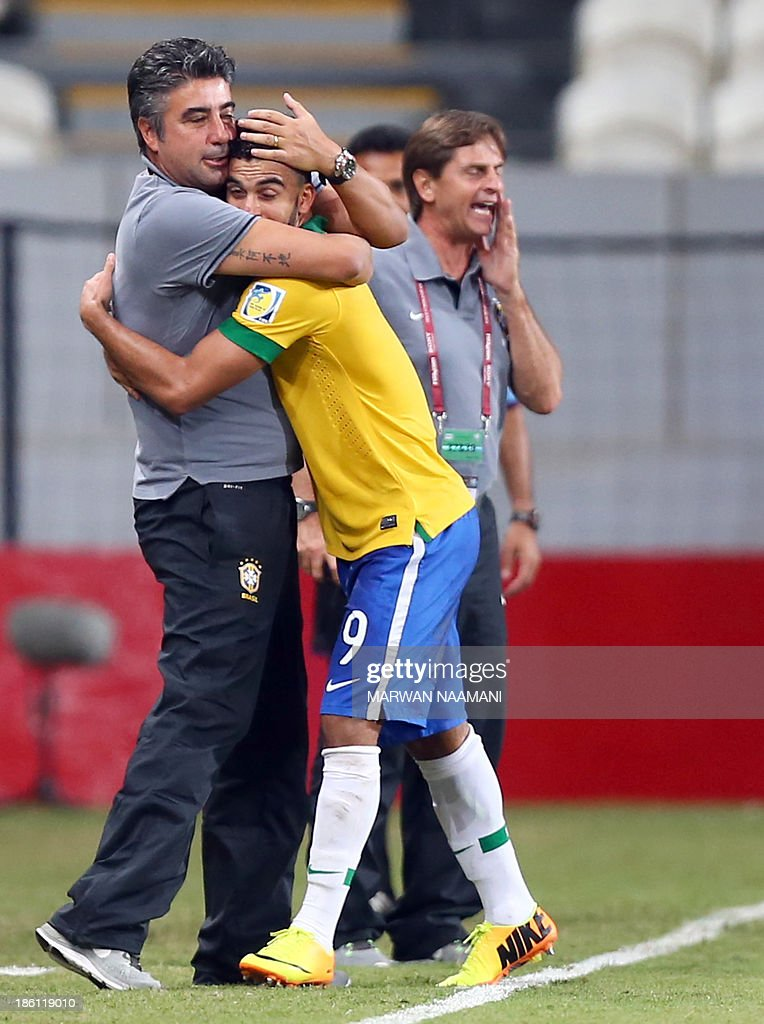 Mosquito (R) of Brazil jubilates with his coach Alexander Gallo after scoring a goal against Russia during their game in round 16 of the FIFA U-17 World Cup at the Mohammad Bin Zayed Stadium in Abu Dhabi, on October 28, 2013.