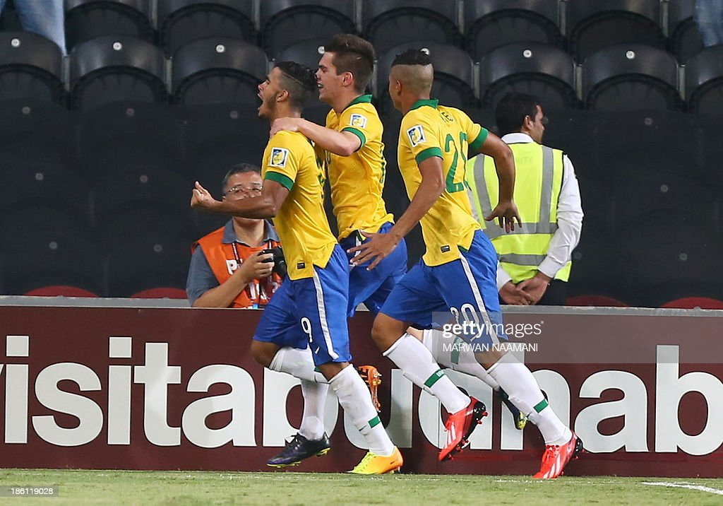Mosquito (L) of Brazil jubilates with his team mates after scoring a goal against Russia during their game in round 16 of the FIFA U-17 World Cup at the Mohammad Bin Zayed Stadium in Abu Dhabi, on October 28, 2013.