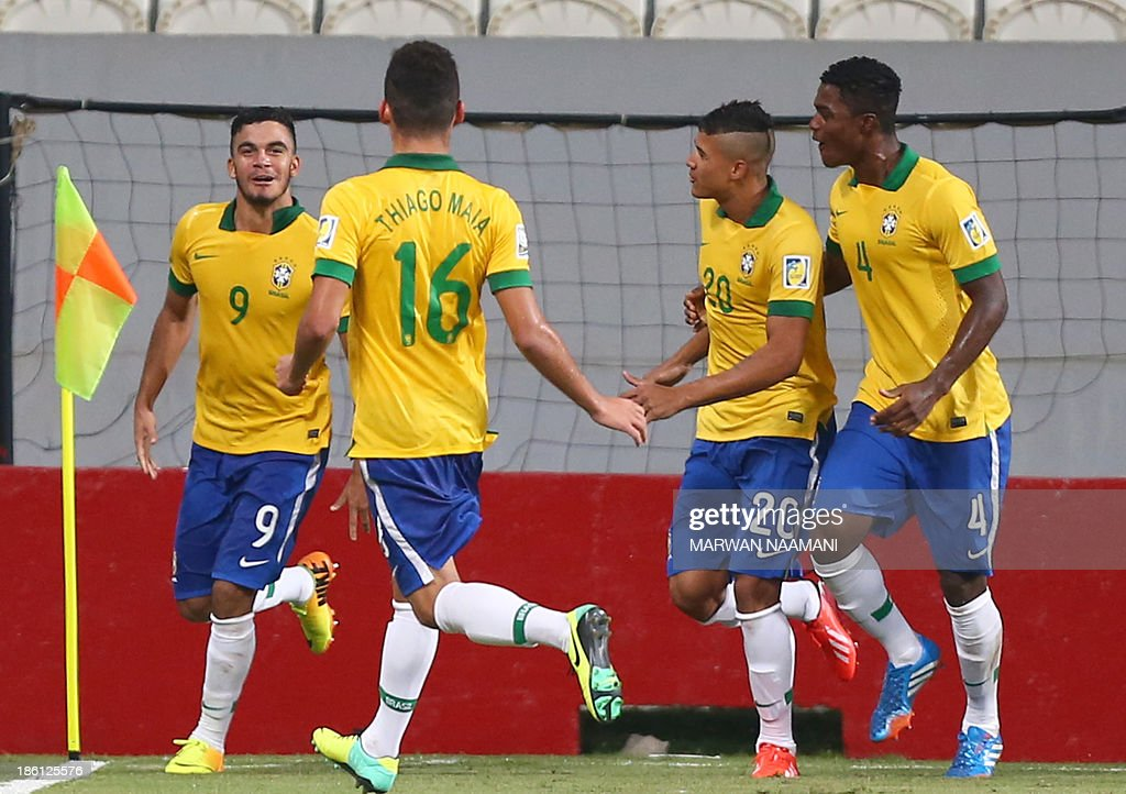 Mosquito (L) of Brazil jubilates with his team mates after scoring a goal against Russia during their game in round 16 of the FIFA U-17 World Cup at the Mohammad Bin Zayed Stadium in Abu Dhabi, on October 28, 2013. Brazil qualified to the quarter final beating Russia 3-1.