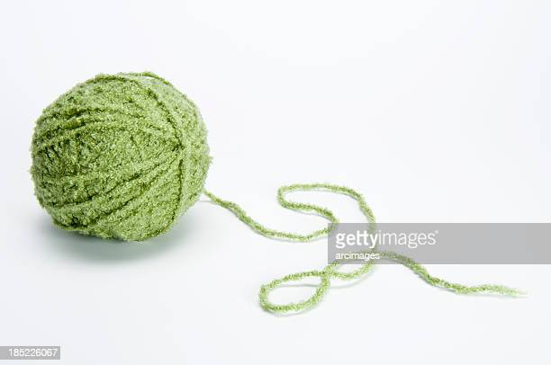 moss green ball of yarn on white background