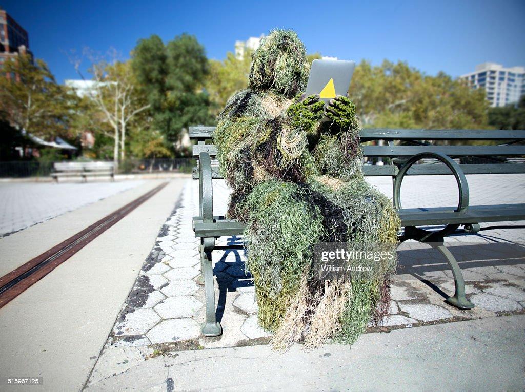 Moss monster using tablet computer
