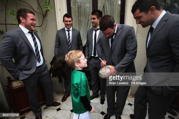 Mossie Moloney gets his rugby ball signed by Jack McGrath Peter O'Mahony Conor Murray Fergus McFadden and Rob Kearney during a reception at Farmleigh...