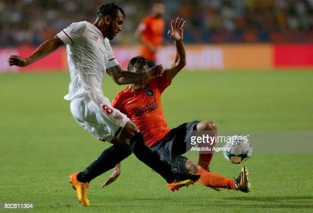 Mossoro of Medipol Basaksehir in action against Walter Montoya of Sevilla FC during the UEFA Champions League playoff match between Medipol...