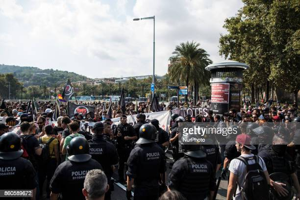 Mossos d'Esquadra Catalan regional police officers stand guard during an antifascist demonstration on Spain's National Day in Barcelona Spain October...