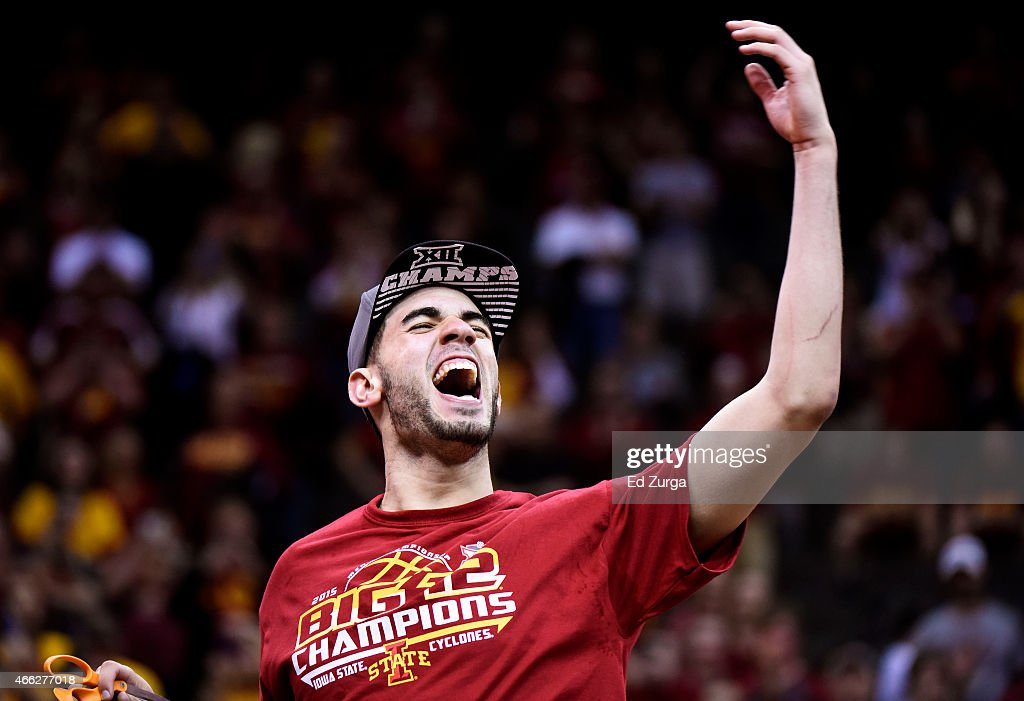 Most outstanding player <a gi-track='captionPersonalityLinkClicked' href=/galleries/search?phrase=Georges+Niang&family=editorial&specificpeople=10061173 ng-click='$event.stopPropagation()'>Georges Niang</a> #31 of the Iowa State Cyclones cuts down a piece of the net after their 70 to 66 victory over the Kansas Jayhawks during the championship game of the Big 12 Basketball Tournament at Sprint Center on March 14, 2015 in Kansas City, Missouri.