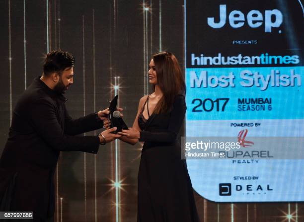 Most Stylish Fashion Personality Award to Nikhil Thampi presented by Esha Gupta during the HT Mumbai's Most Stylish Awards 2017 at Taj Lands End...