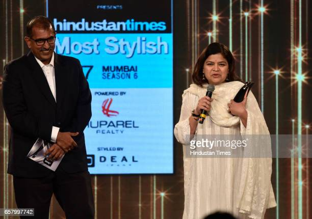 Most Stylish political leader Poonam Mahajan presented Deputy Editor Pravin Chandran Nair during HT Mumbais Most Stylish Awards 2017 at Taj Lands End...