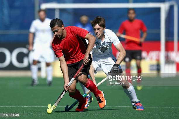 Mostafa Mansour of Egypt and Marcus Child of New Zealand battle for possession during the 5th8th place play off match between Egypt and New Zealand...