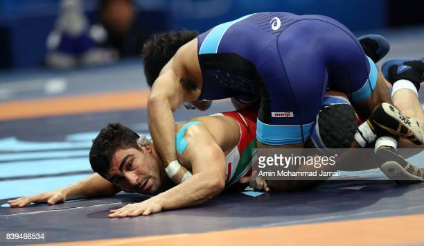 Mostafa Mohabbali Hosseinkhani of Iran in action against Yuhi Fujinami of Japan during World Wrestling Championships in Quarterfinal freestyle...