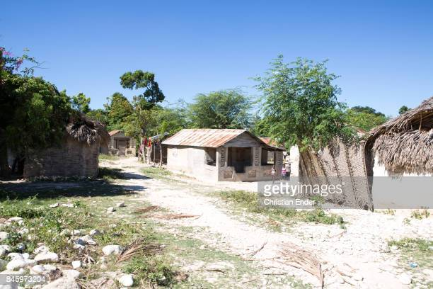 PortauPrince Haiti December 09 2012 A mostly damaged village destroyed from the devastating earthquake in 2010 One building seems occupied