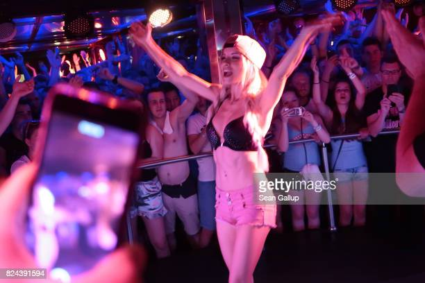 Mostly Germanspeaking visitors cheer to the performance of German singer Mia Julia a former porn actress at the Oberbayern disco on the Ballermann...