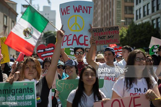 A mostly immigrant crowd participates in a May Day march by the Coalition for Humane Immigrant Rights of Los Angeles on May 1 2016 in Los Angeles...