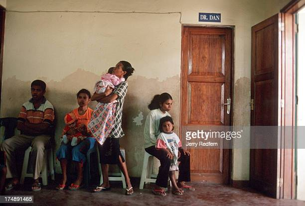 Mostly women and children line up outside the examination room door at the Bairo Pite Clinic Dr Dan Murphy says that few men come to the clinic...