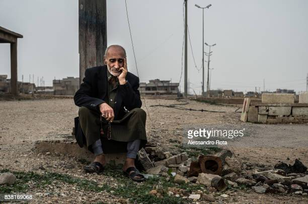 IRAQ Mosul West 12 Mar 2017 A family member of died civilian cries next to the graveyard in the Mansur neighboord