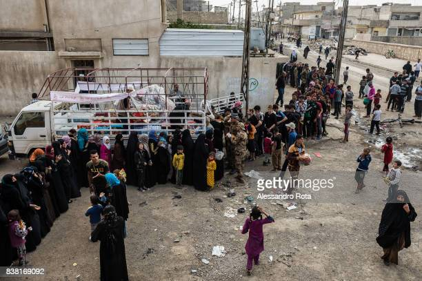IRAQ Mosul West 12 Mar 2017 Civilians from Mansor neighboorhood gather for a food distribution by an NGO based in East Mosul