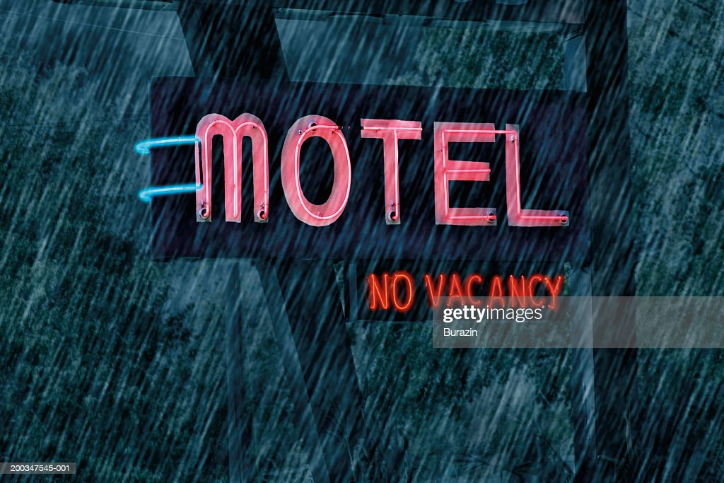 'Motel' and 'No Vacancy'  sign in rain : Stock Photo
