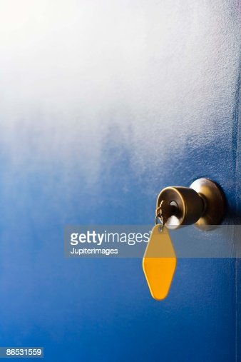 Motel room key in doorknob