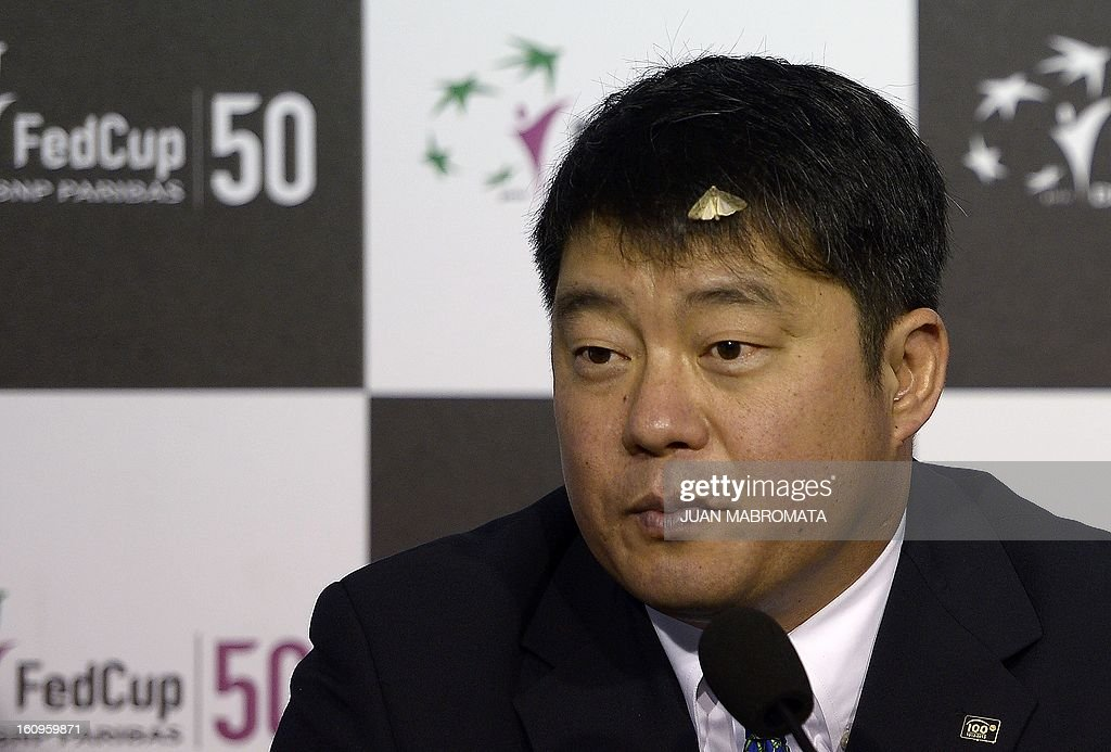 A moth alights on referee Tony Cho during the draw of the 2013 Fed Cup World Group II first round between Argentina and Sweden to be held this weekend in Buenos Aires, at Parque Roca stadium in the Argentine capital, on February 8, 2012. AFP PHOTO / Juan Mabromata