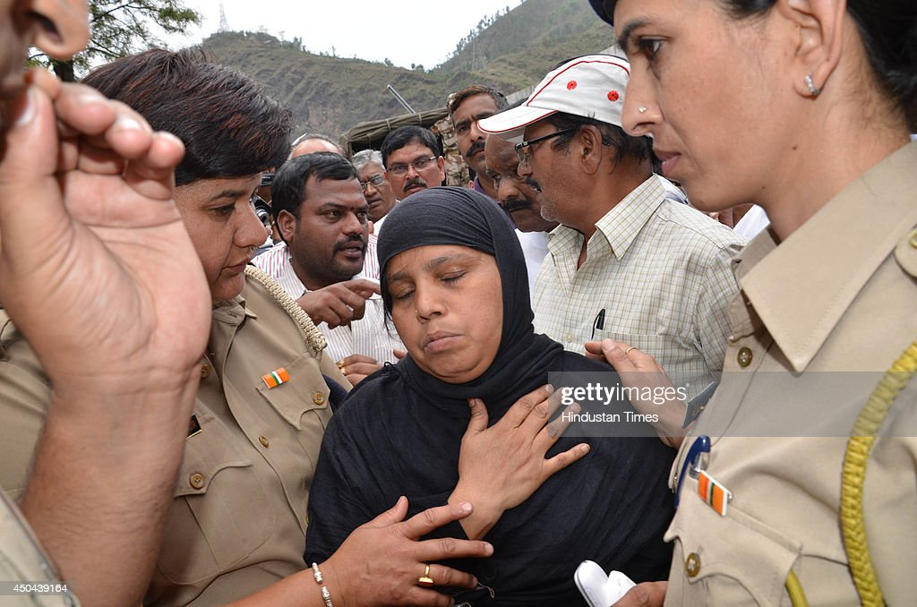 Mother Aisa Hussain after she identified dead body of her son Mohammad Shabir Hussain which was recovered from Beas river during search operation on June 11, 2014 in Mandi, India. The rescue team had recovered six bodies so far from the river. A wall of water washed away 24 engineering students and a tour operator Sunday evening after water was released into the river allegedly without a warning from a nearby Pandoh Dam on Beas River.