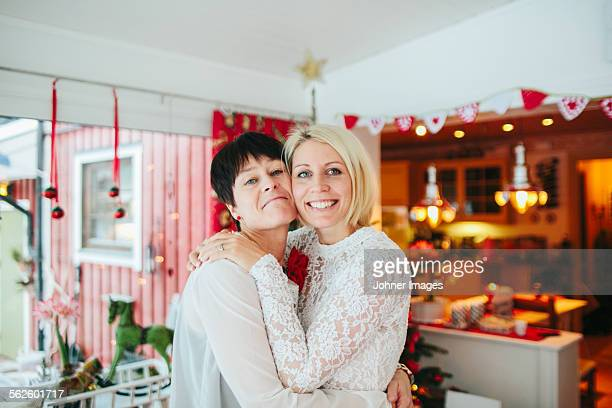 Mother and adult daughter at Christmas