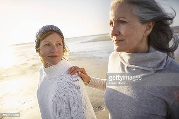 Mother and adult daughter on beach