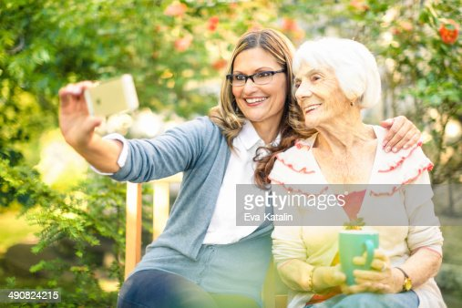 Mother and adult daughter together : Stock Photo