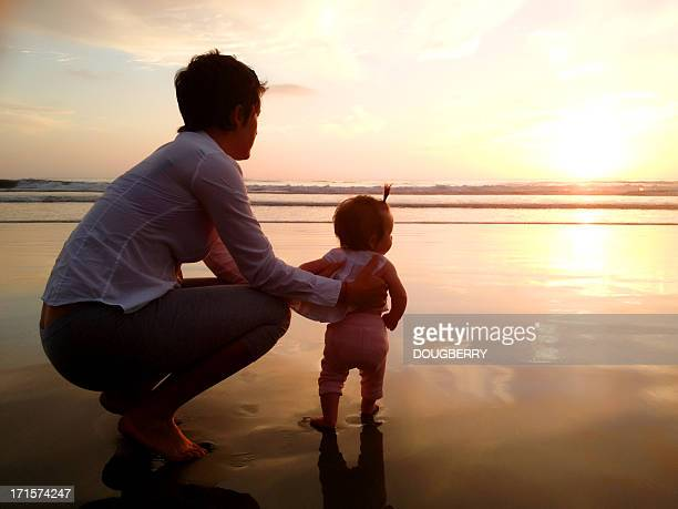 Mother and baby at beach