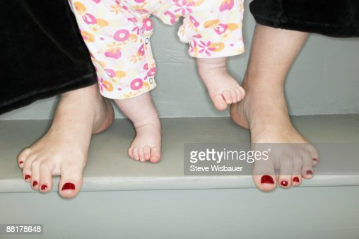 Mother and baby bare feet : Stock Photo
