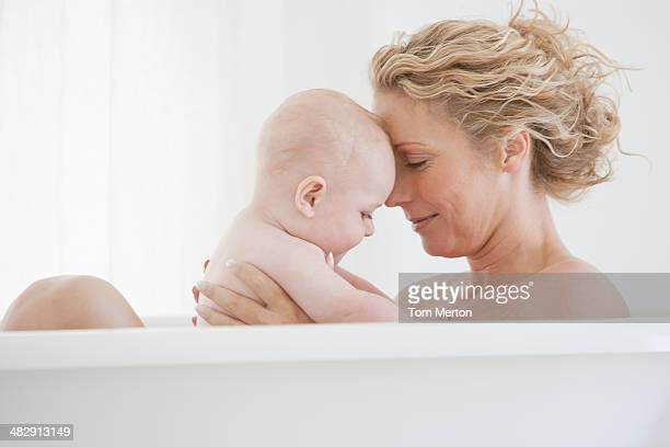 Mother and baby bathing