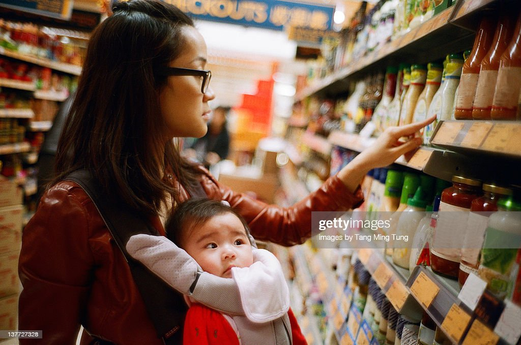 Mother and baby boy at supermarket : Stock Photo