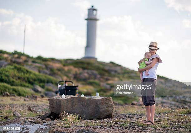 Mother and baby boy at the seaside
