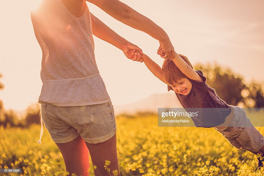 Mother and baby boy having fun at the field : Stock Photo
