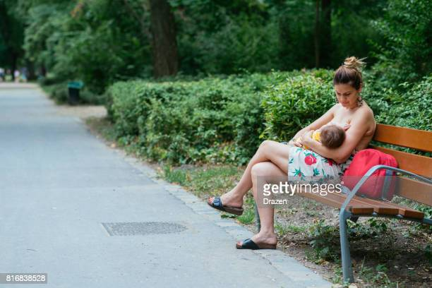 Mother and baby breastfeeding in public