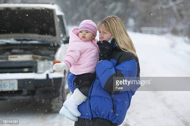 Mother and Baby Broken Down in Snow
