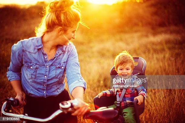 Mother and baby cycling together
