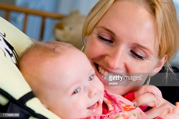 mother and baby daughter having fun