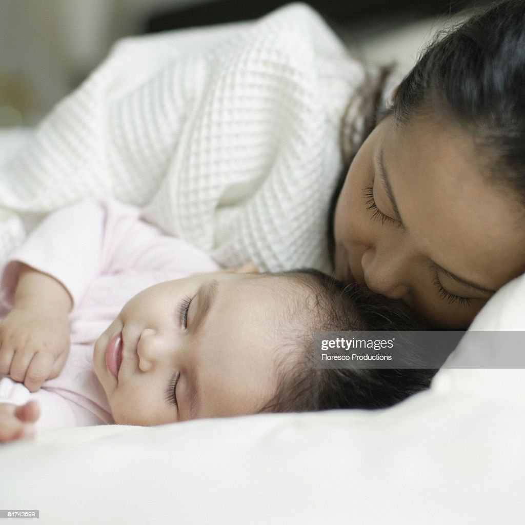 Mother and baby daughter sleeping : Stock Photo
